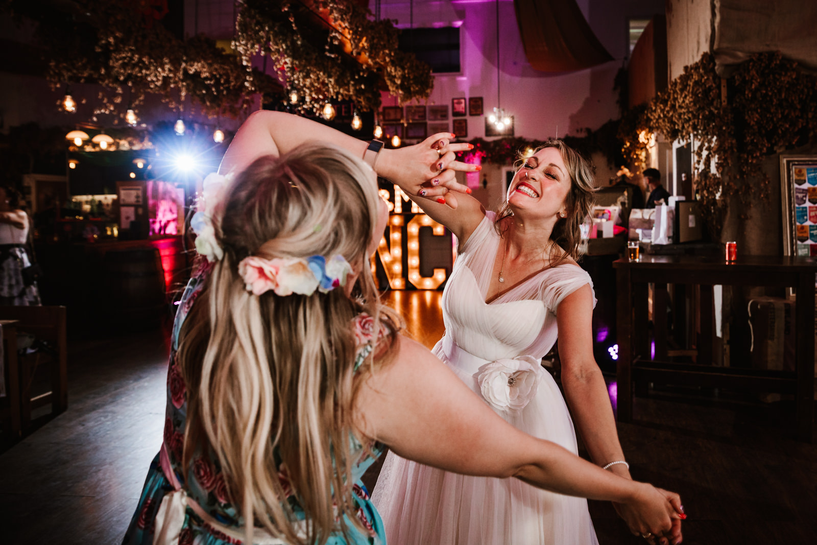 Bride dancing with her bridesmaid