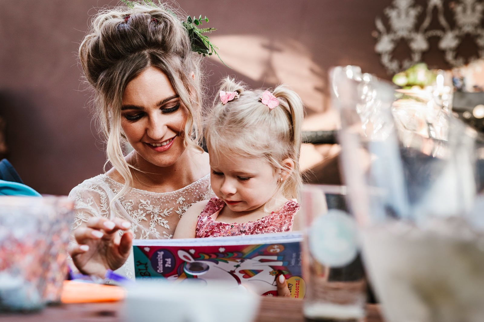 Bride reading with a little girl