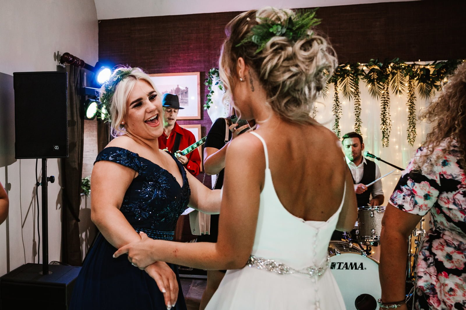 Bride dancing with her sister