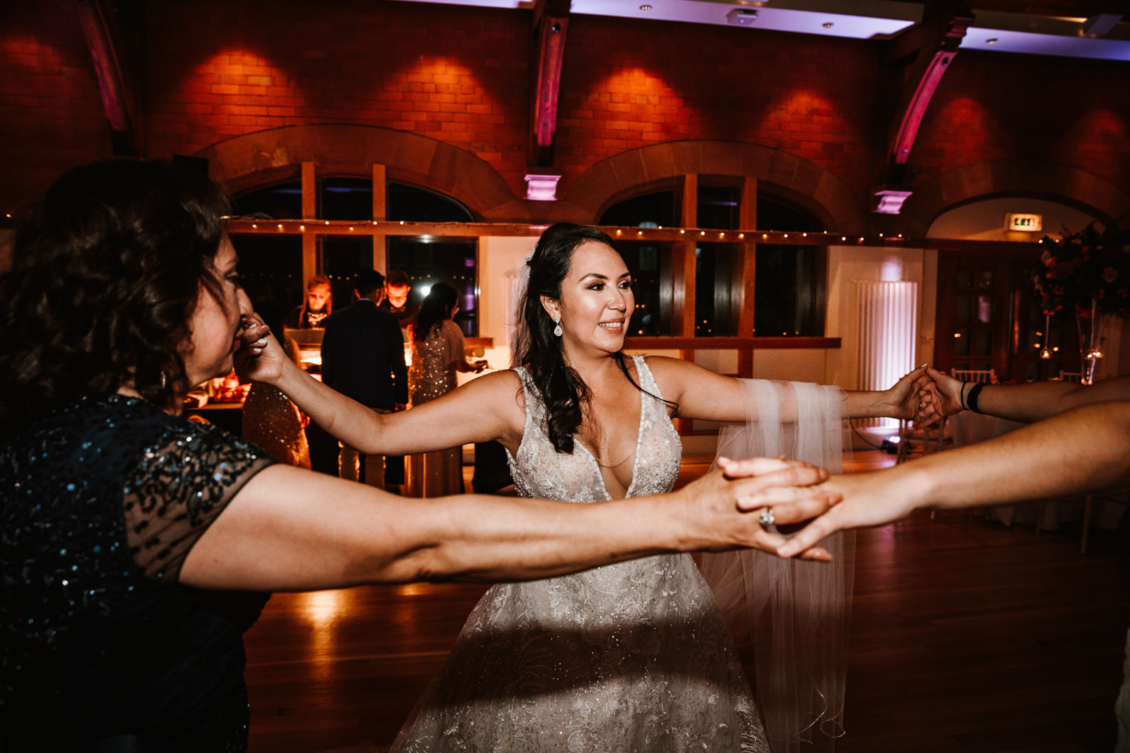 Bride on dance floor with family