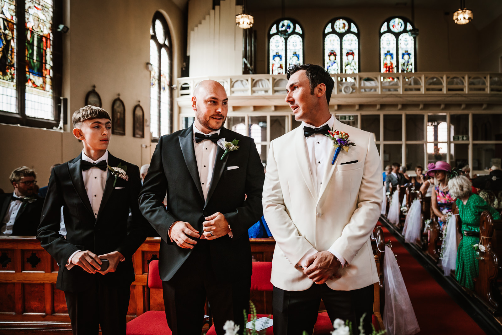 Groom waiting for his bride to be in church