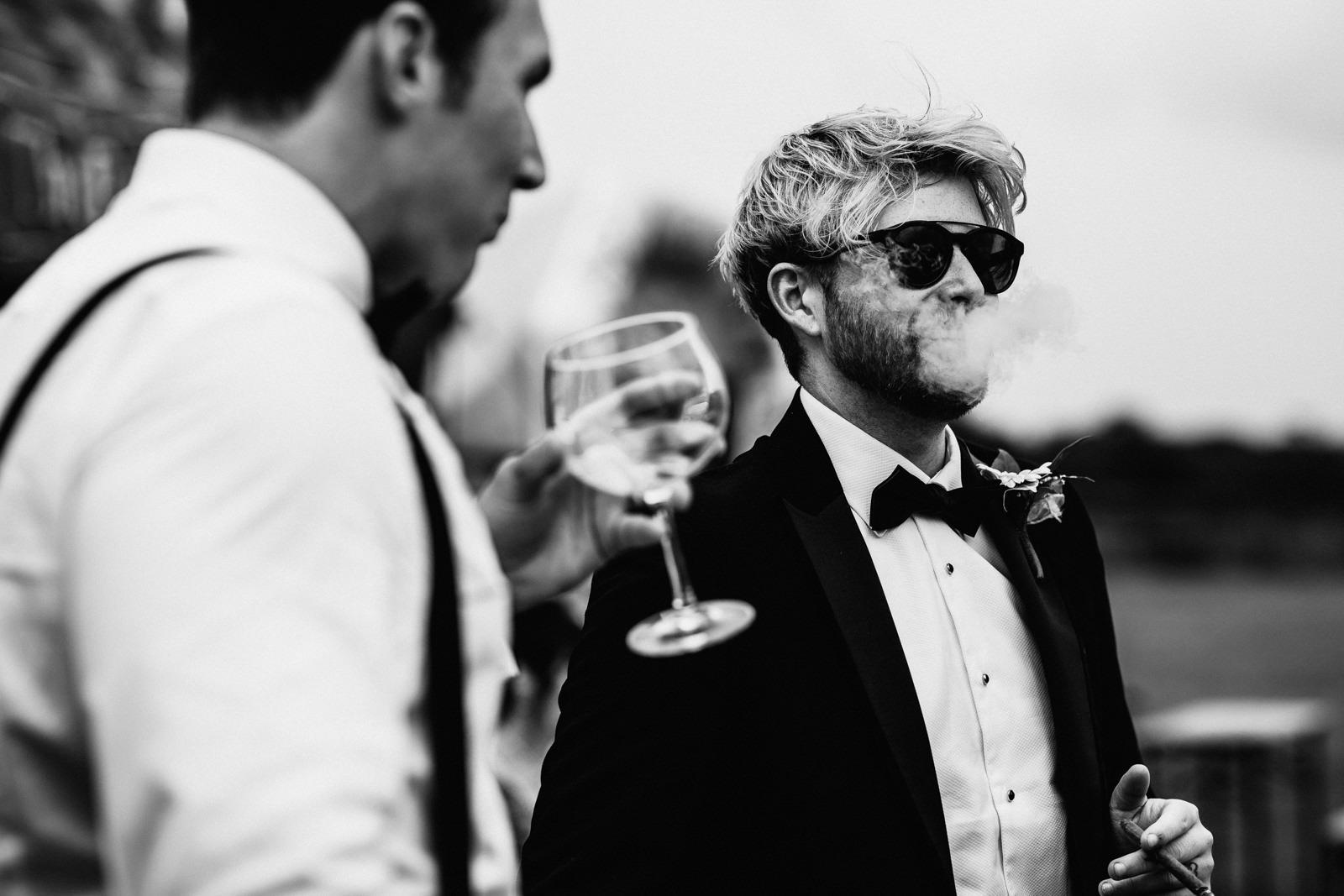 Wedding guest smoking cigar