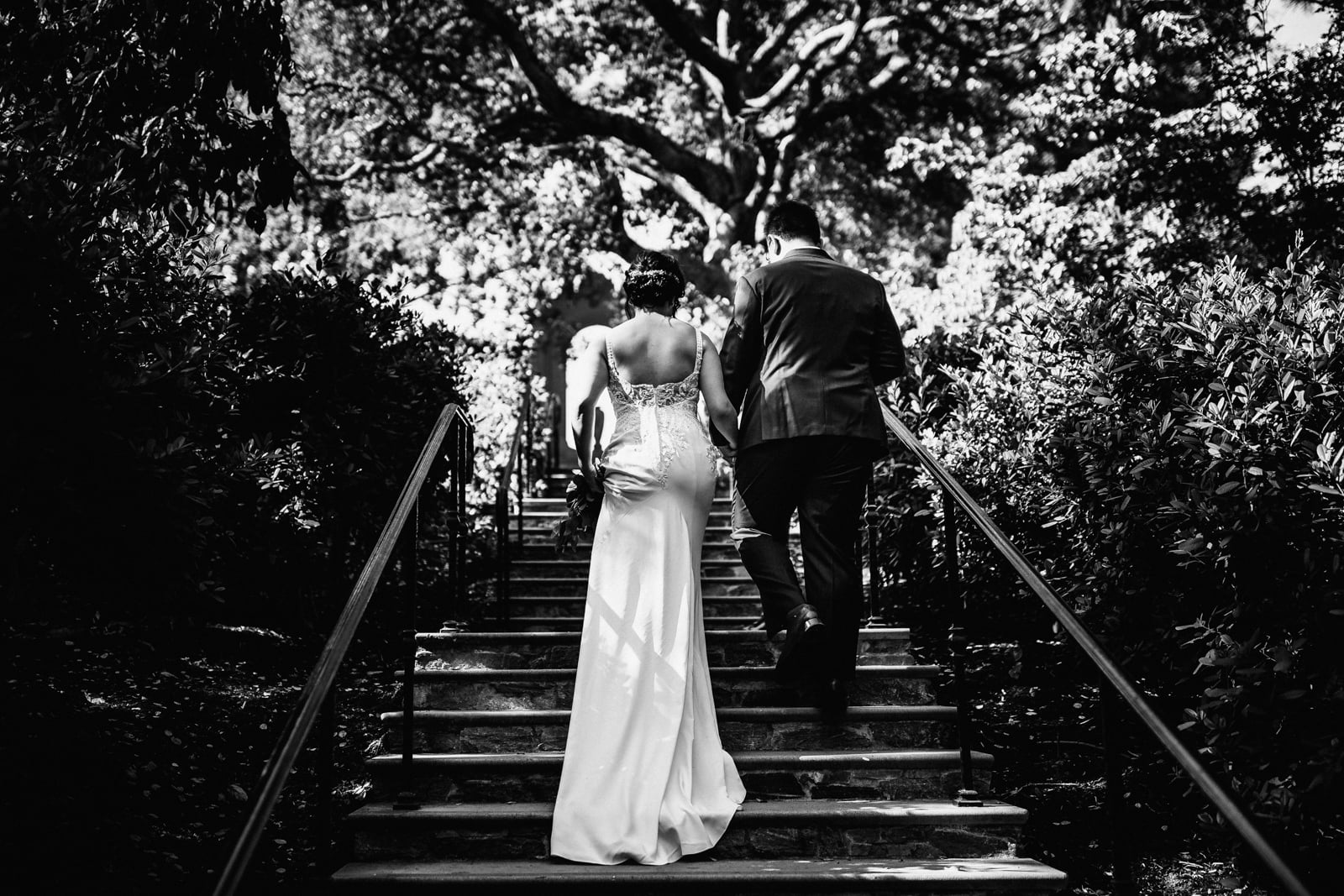 Bride and groom walking up the steps