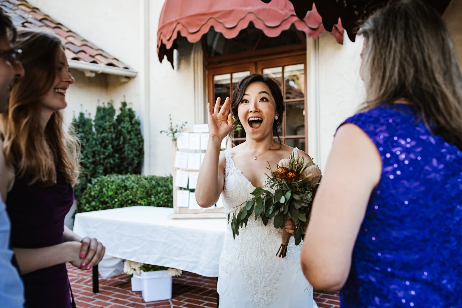 Bride waving to friends