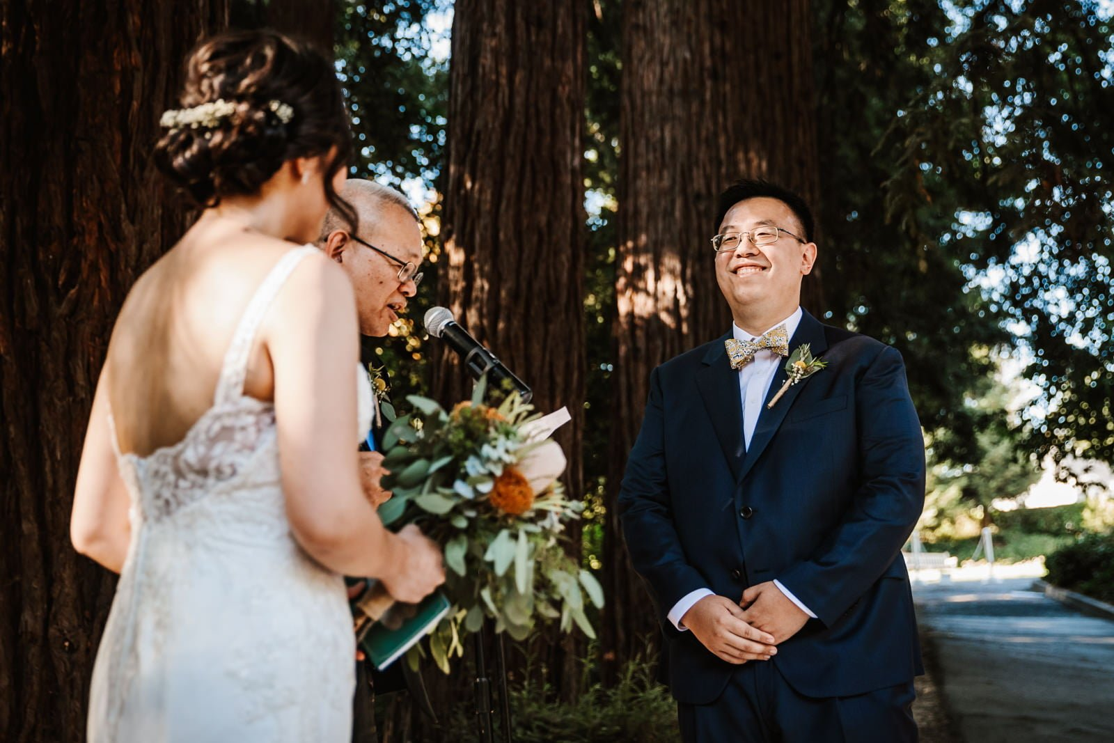 Groom smiling during the ceremony