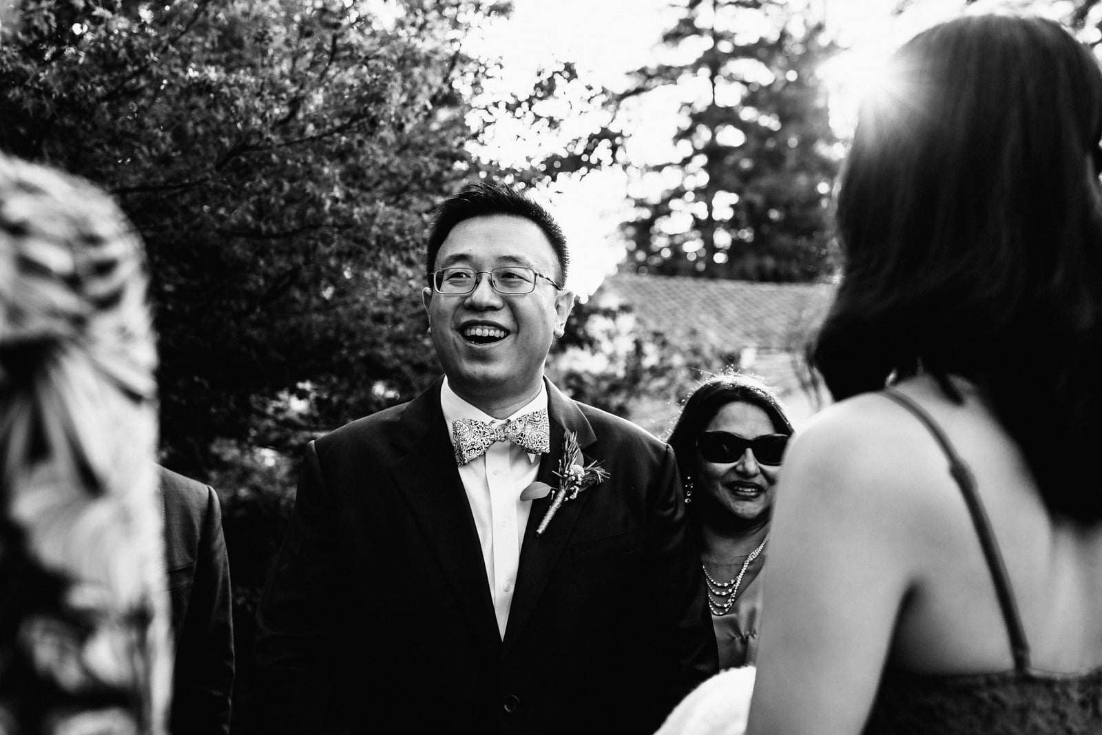Groom smiling with guests