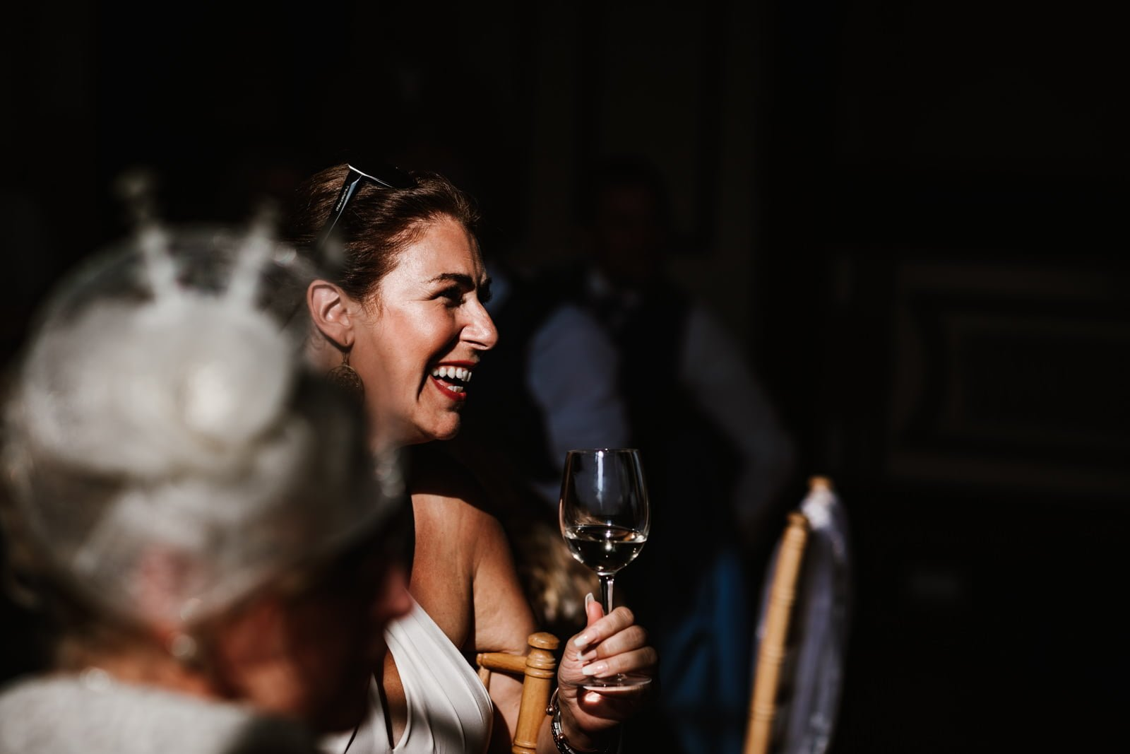 Wedding guest smilingduring speeches