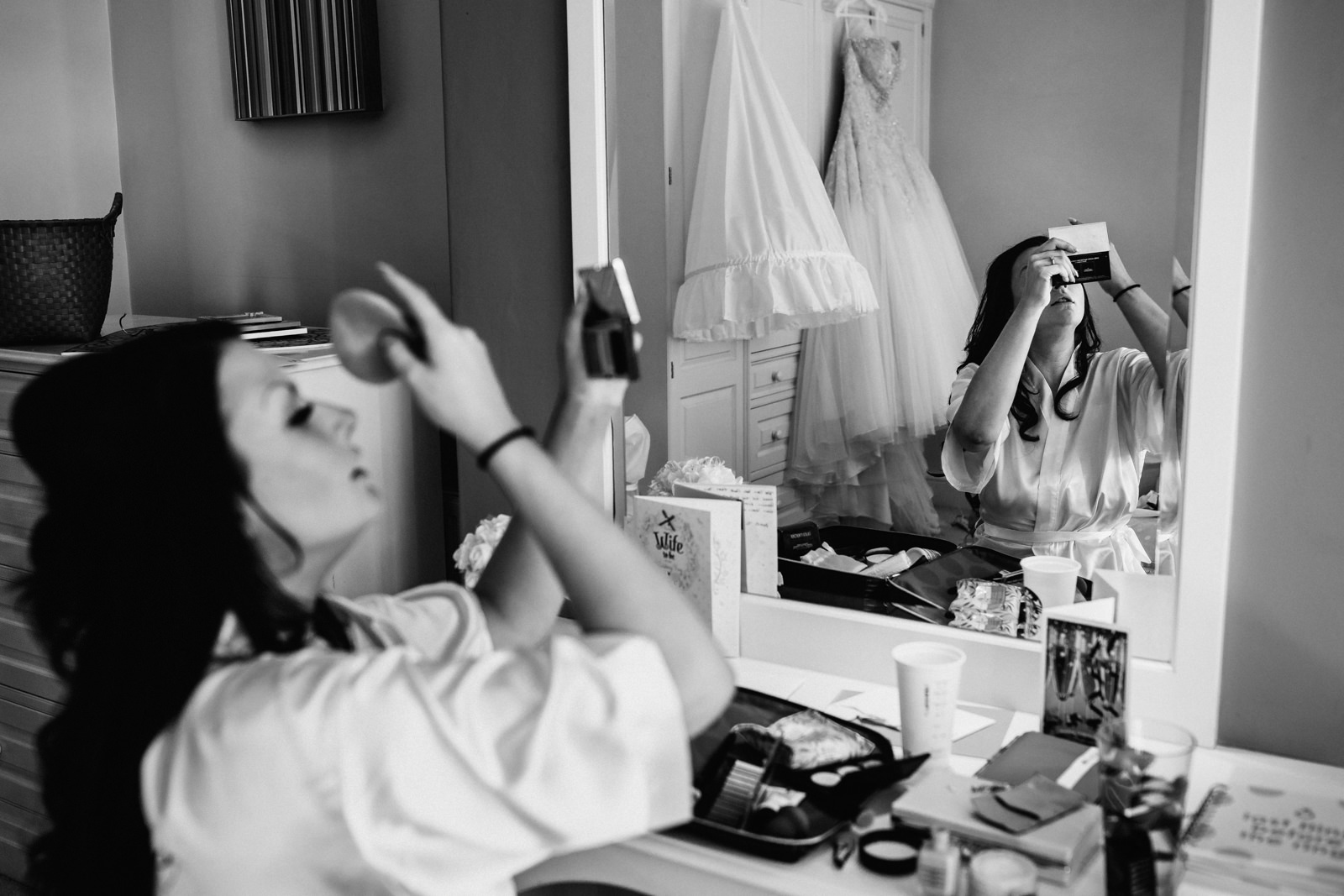 Bride applying her make up