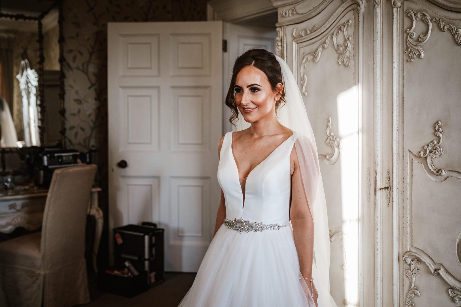 Bride looking beautiful in her wedding dress