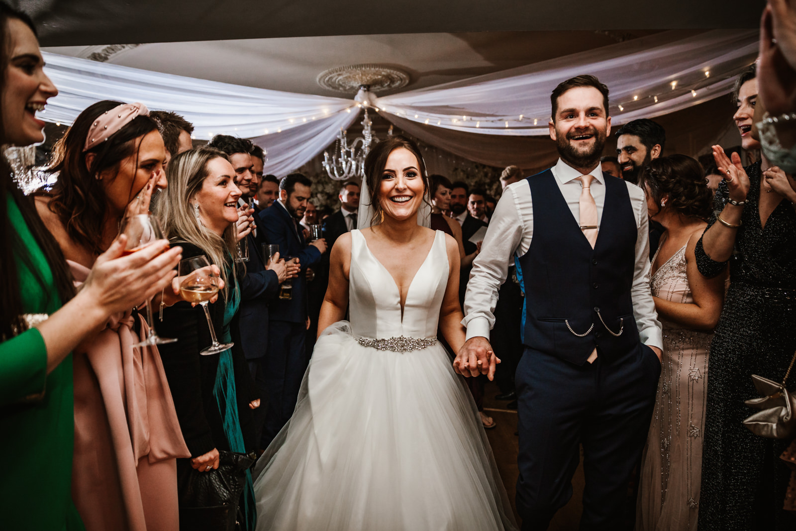 Bride and Groom enter main room at Eaves Hall