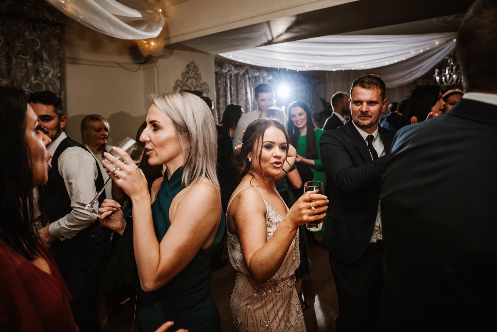 Cool bridesmaid on dance floor