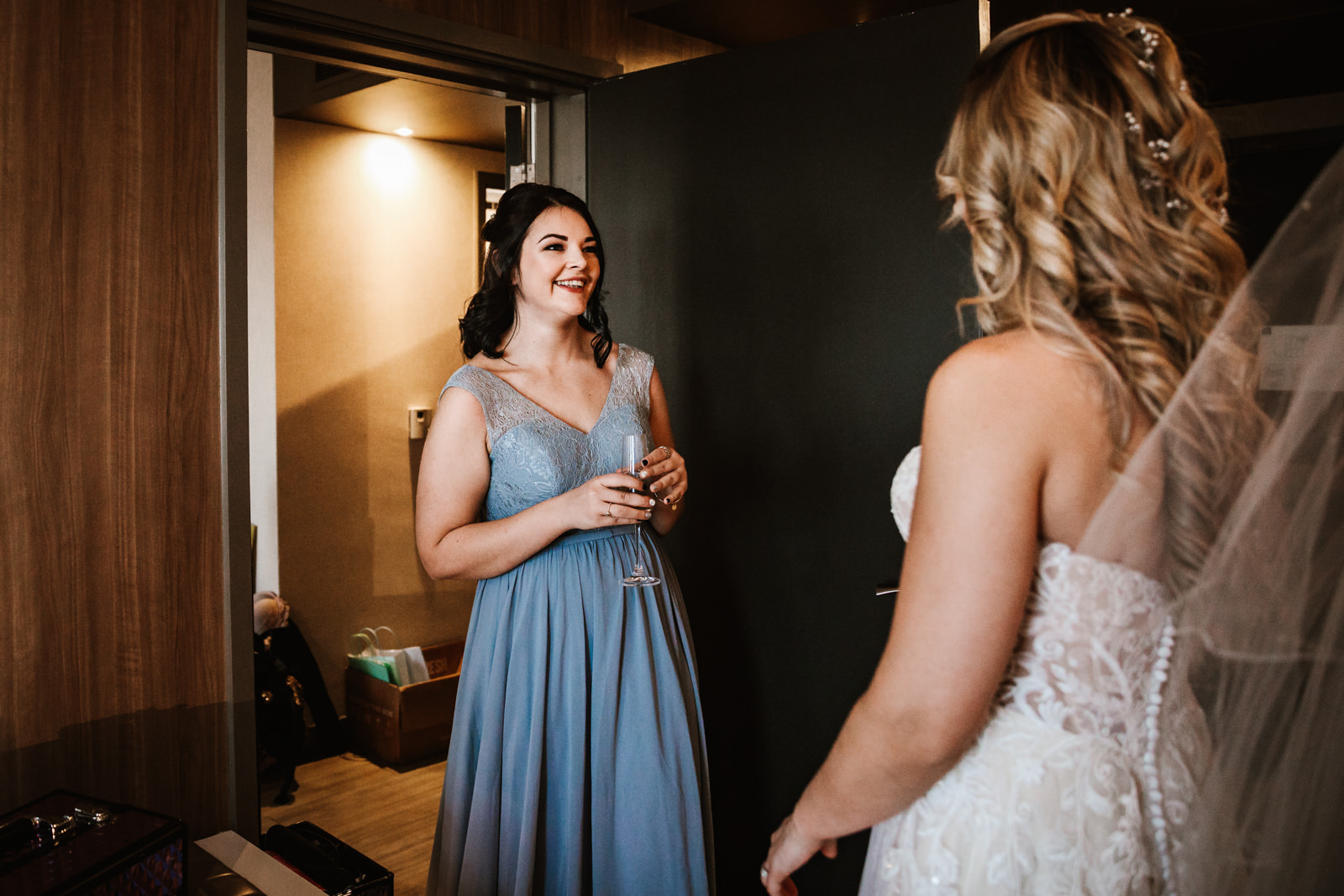 Bridesmaid smiling with the bride