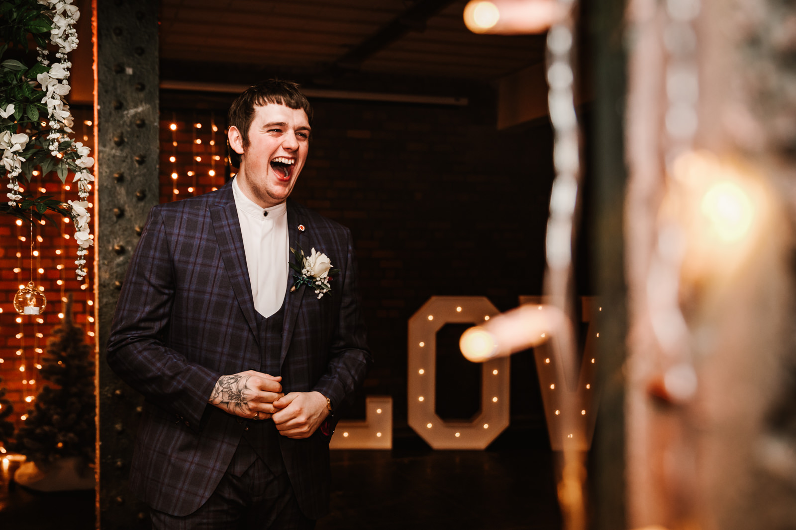 Groom laughing waiting for his bride to be