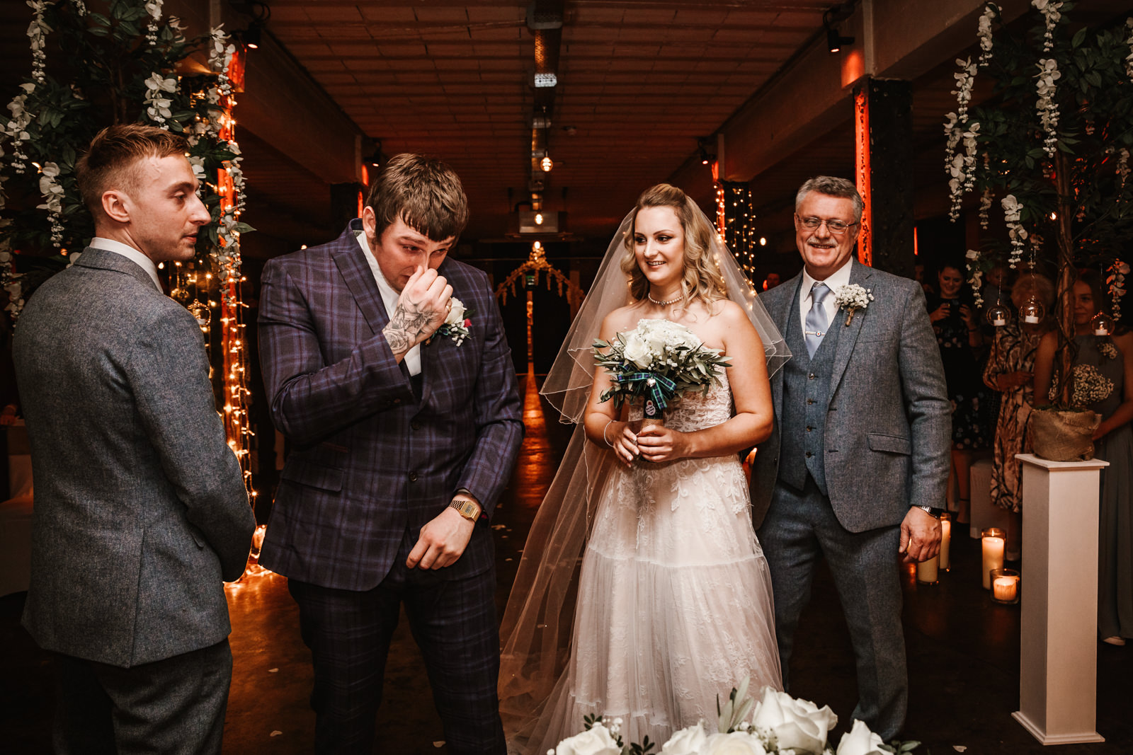 Groom in tears when he first looks at his bride in her wedding dress