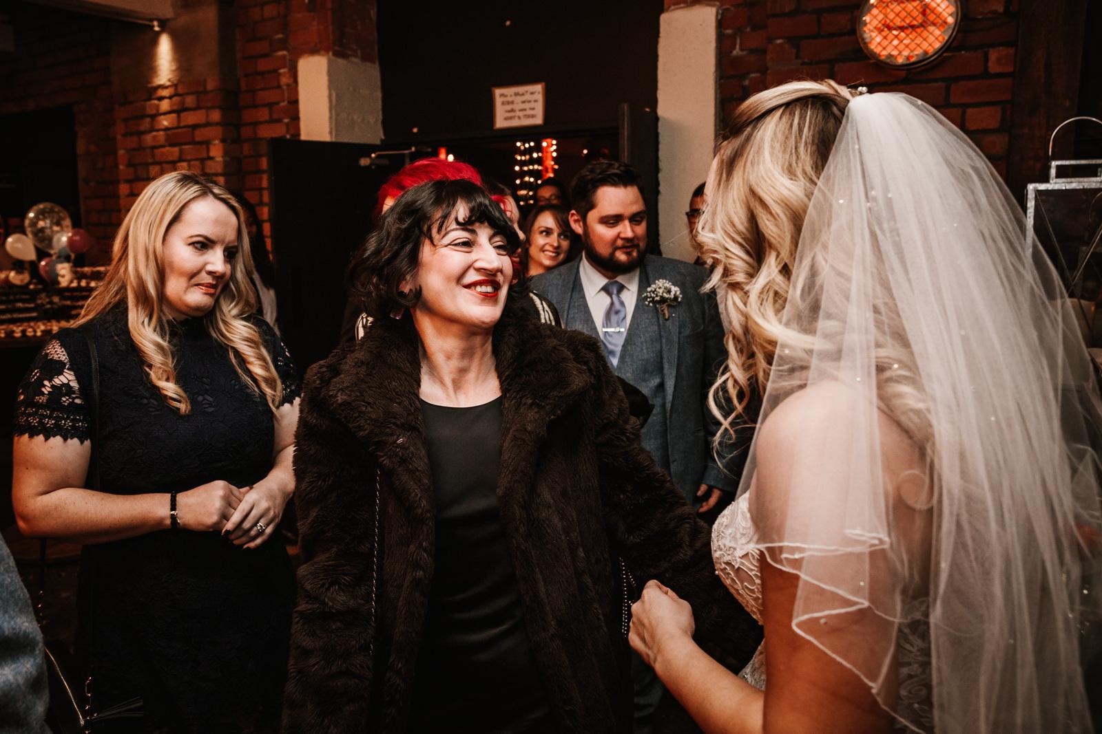 Wedding guest congratulates the bride