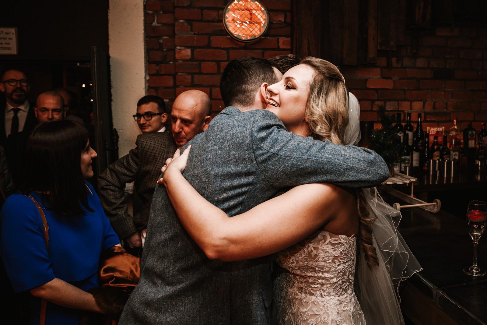 Bride hugging and usher