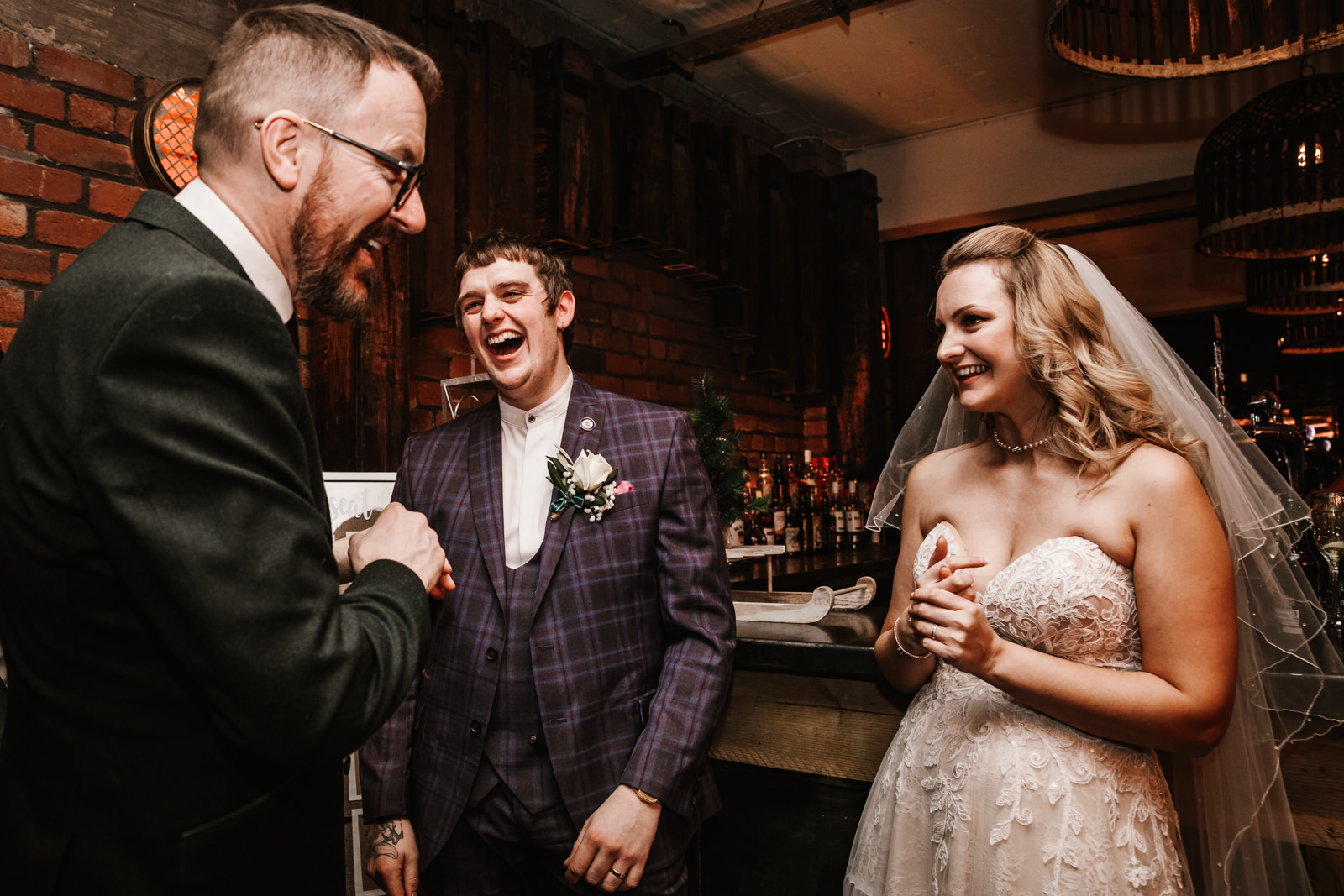 Bride and groom laughing with their guests