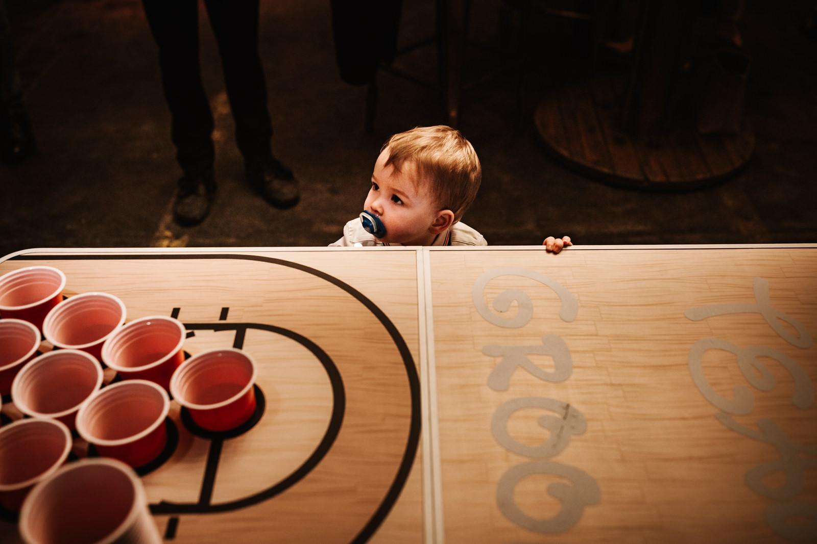 Little boy watching ber pong