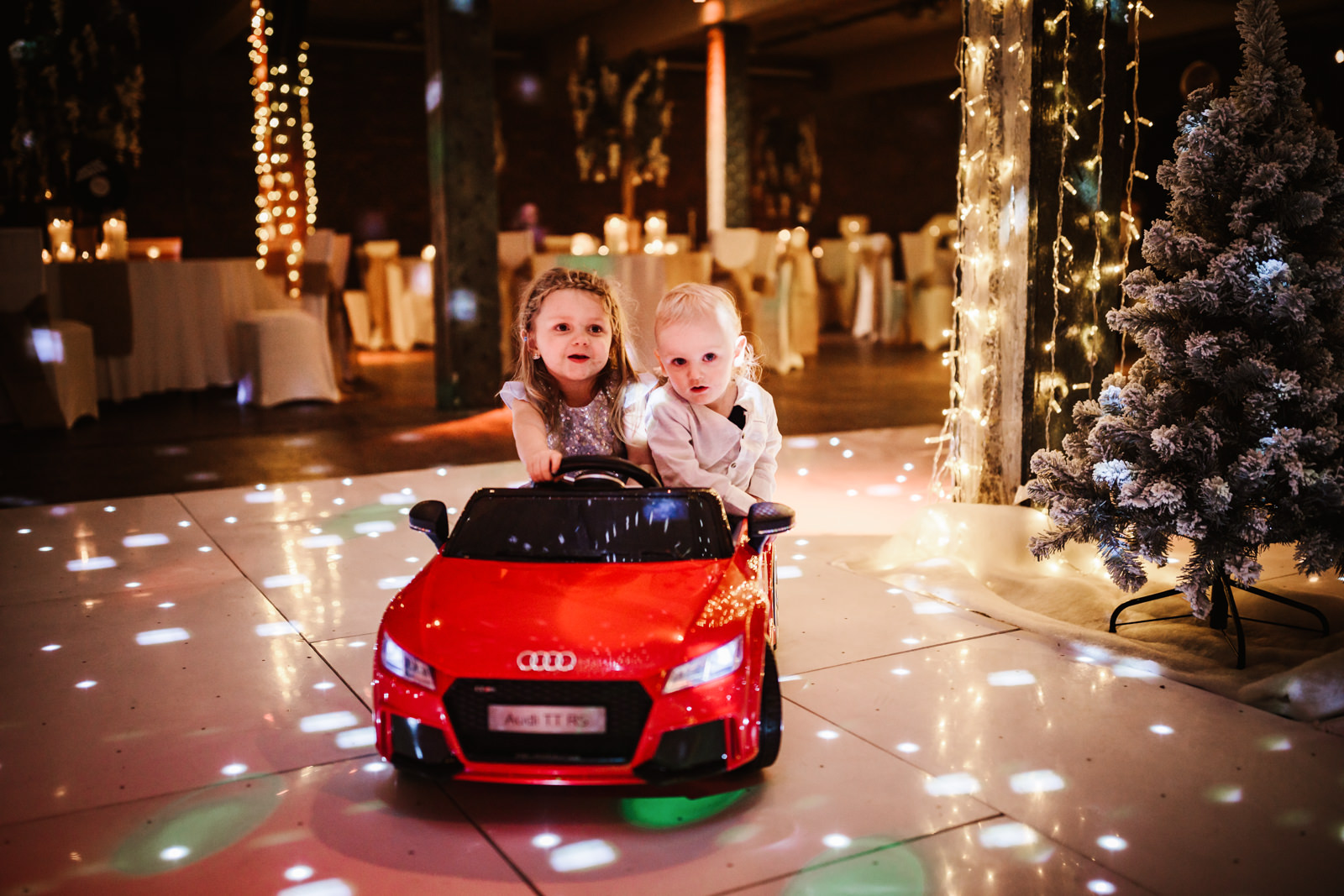 Kids playing in toy car
