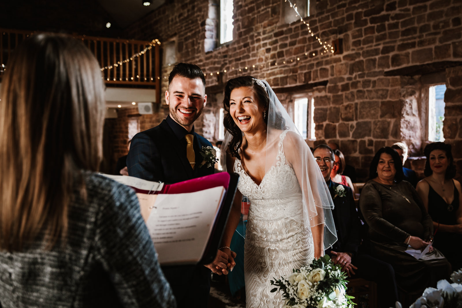 Bride and groom during the ceremony at The Ashes Barns