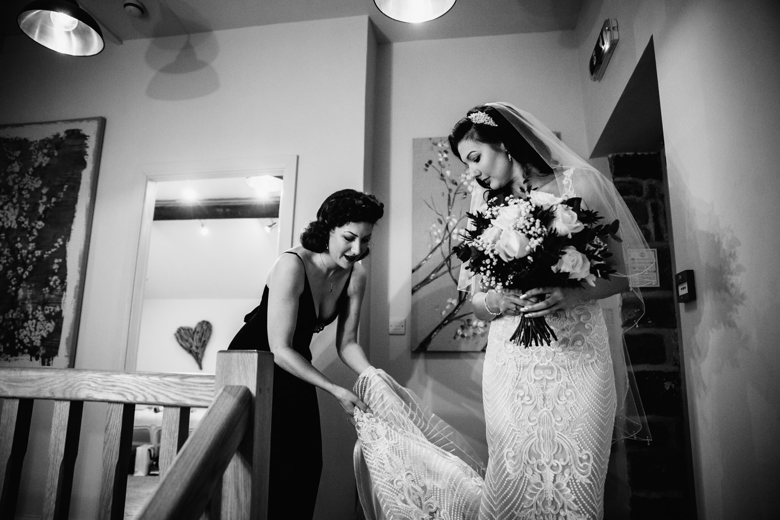 Bride getting help with her wedding dress at The Ashes Barns