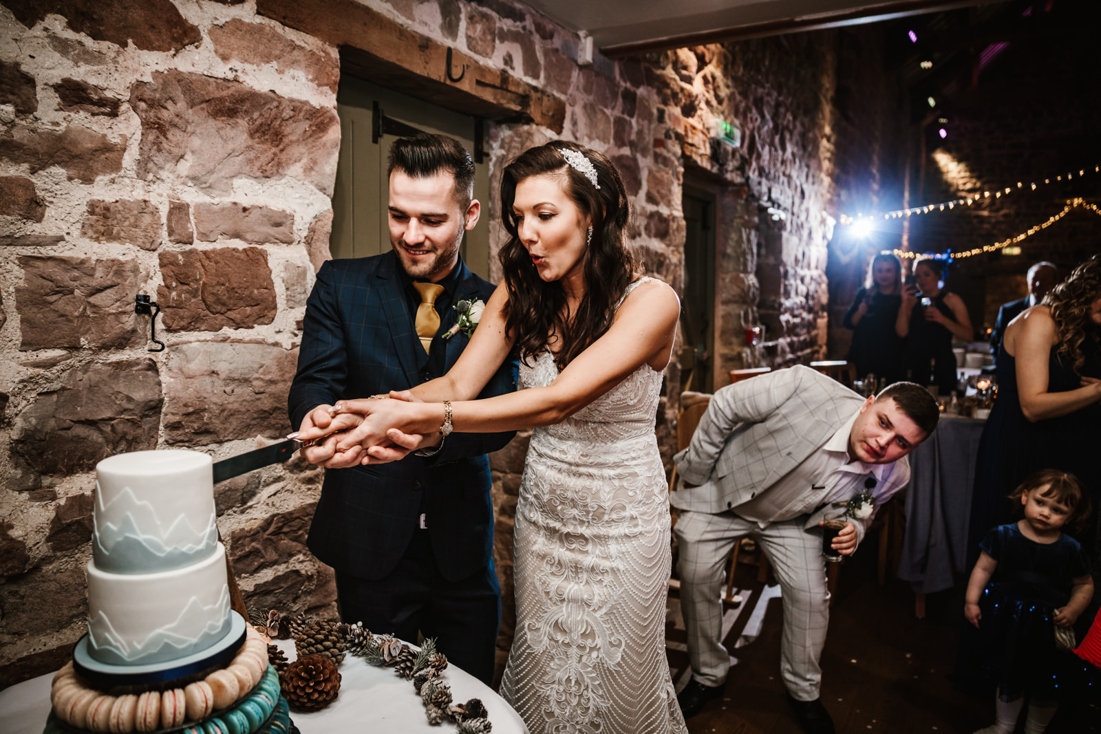 Cutting the cake at The Ashes Barns